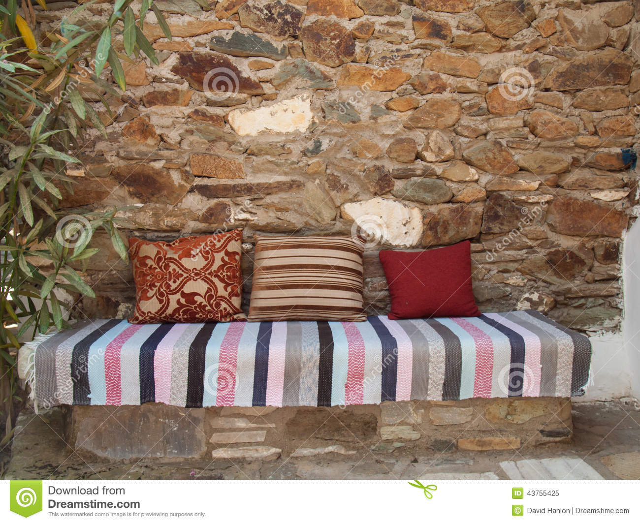 Cushions And Kelim On A Stone Bench Stock Photo Image