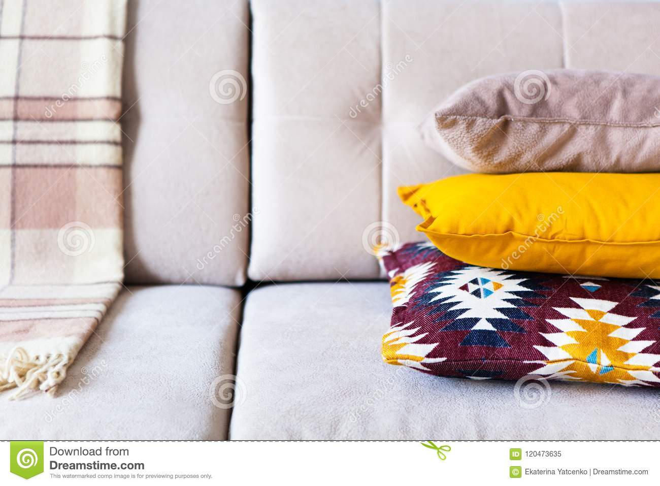 Cushions And Plaid On The Beige Sofa Close Up With Copy Space. S ...