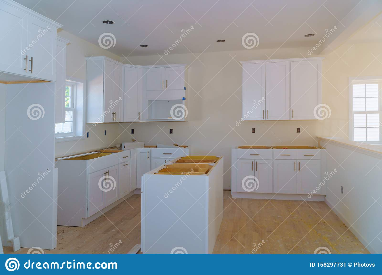 Custom Kitchen Cabinets In Various Stages Of Installation Base For Island In Center Stock Image Image Of Room Remodeling 158297731