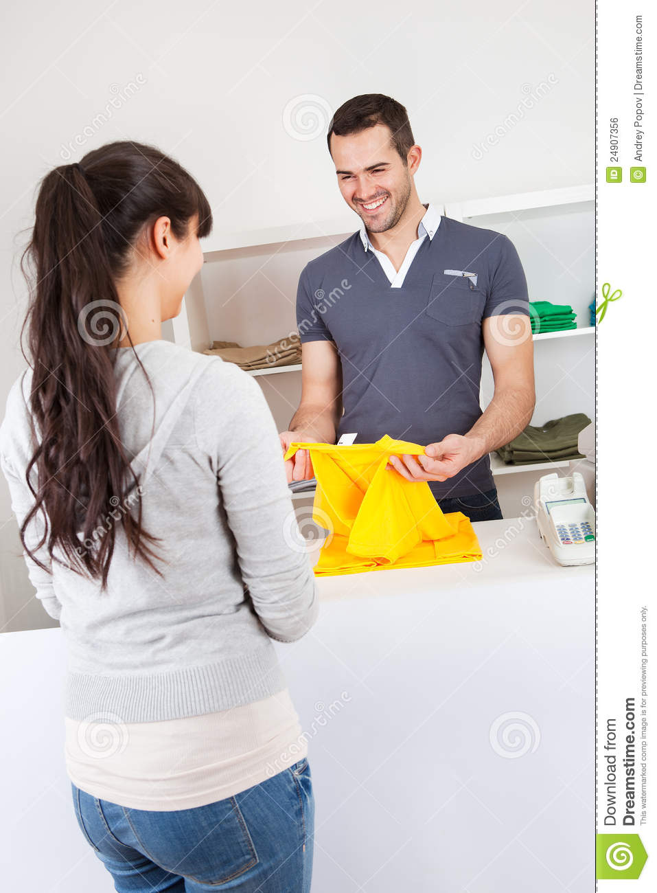 Buying A Full Face Snorkel Mask Reviews Of Full Face: Customer Buying Clothes In Shop Stock Photo