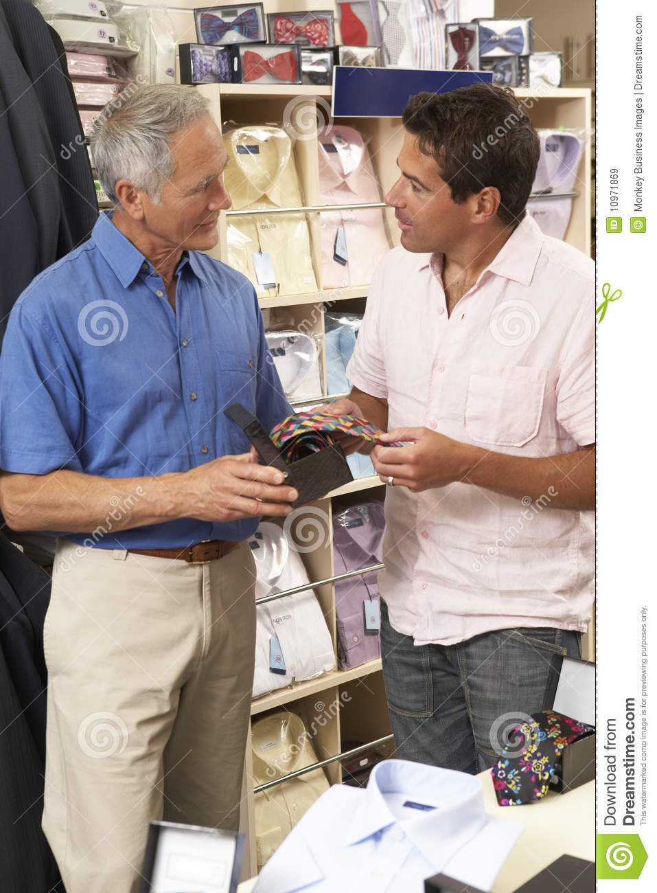 customer in clothing store s assistant royalty stock customer in clothing store s assistant
