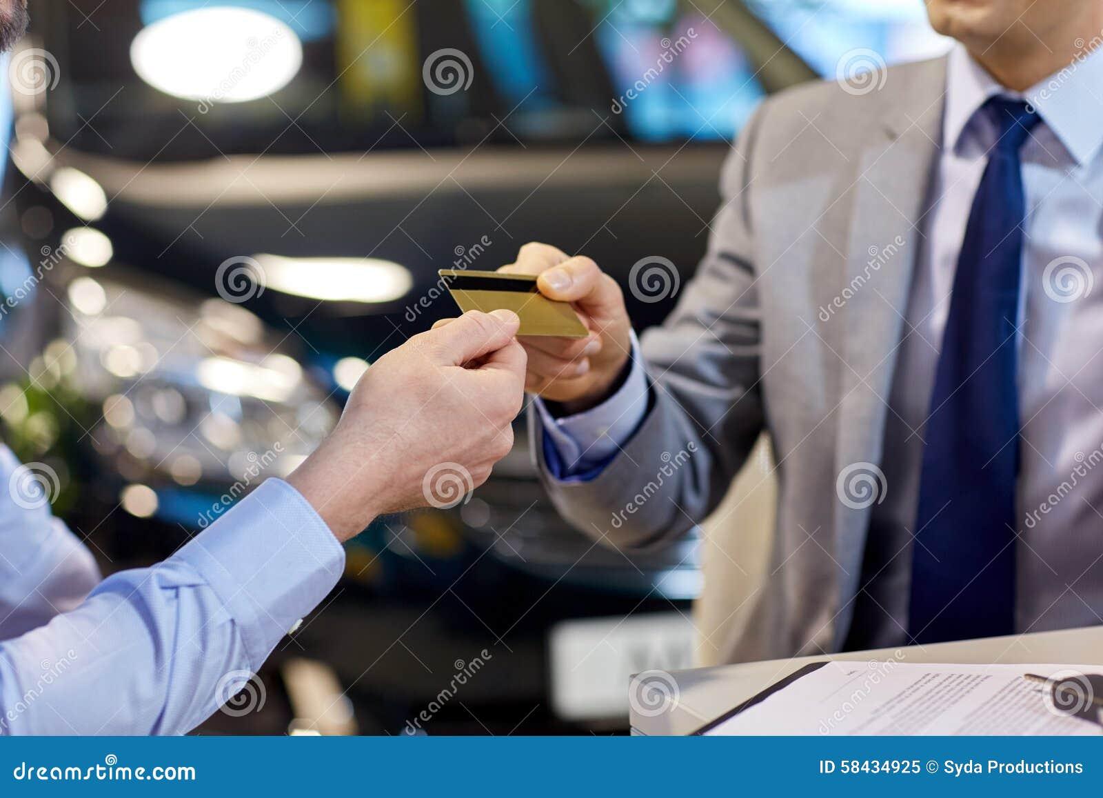 customer giving credit card to car dealer in salon stock image image of customer automobile. Black Bedroom Furniture Sets. Home Design Ideas