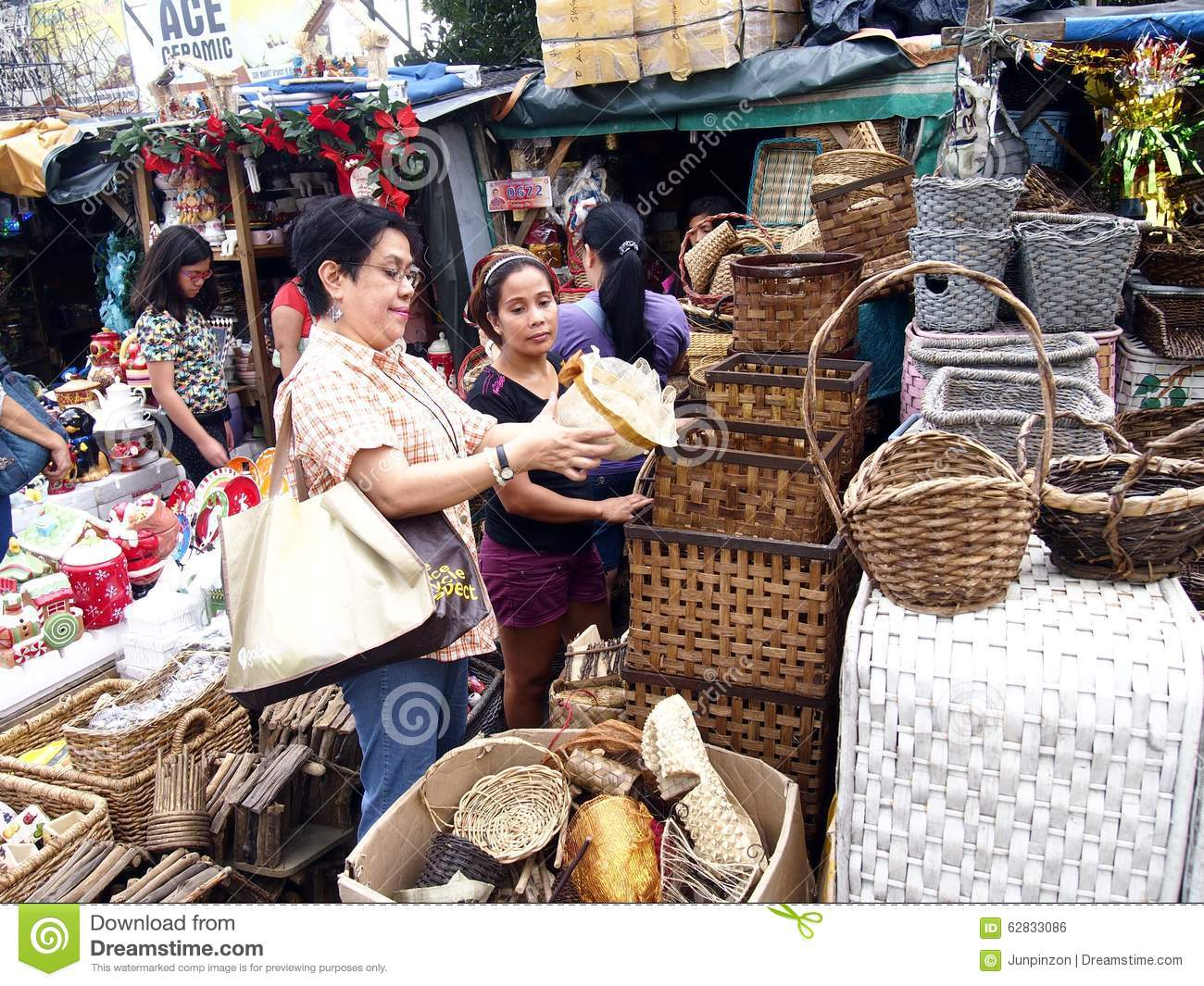 A Customer Inspects A Home Decor Product At A Store In Dapitan Market Editorial Photo Image