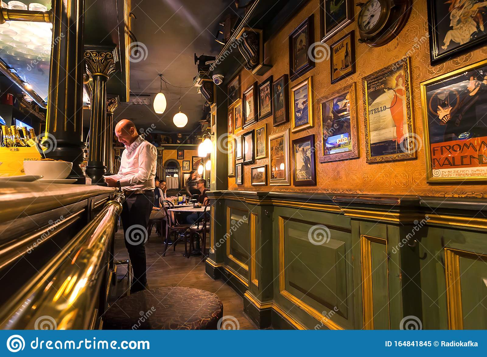 Customer Making An Order At Bar Counter Small Restaurant With Vintage Interior Old Paintings And Posters Editorial Image Image Of Food Europe 164841845