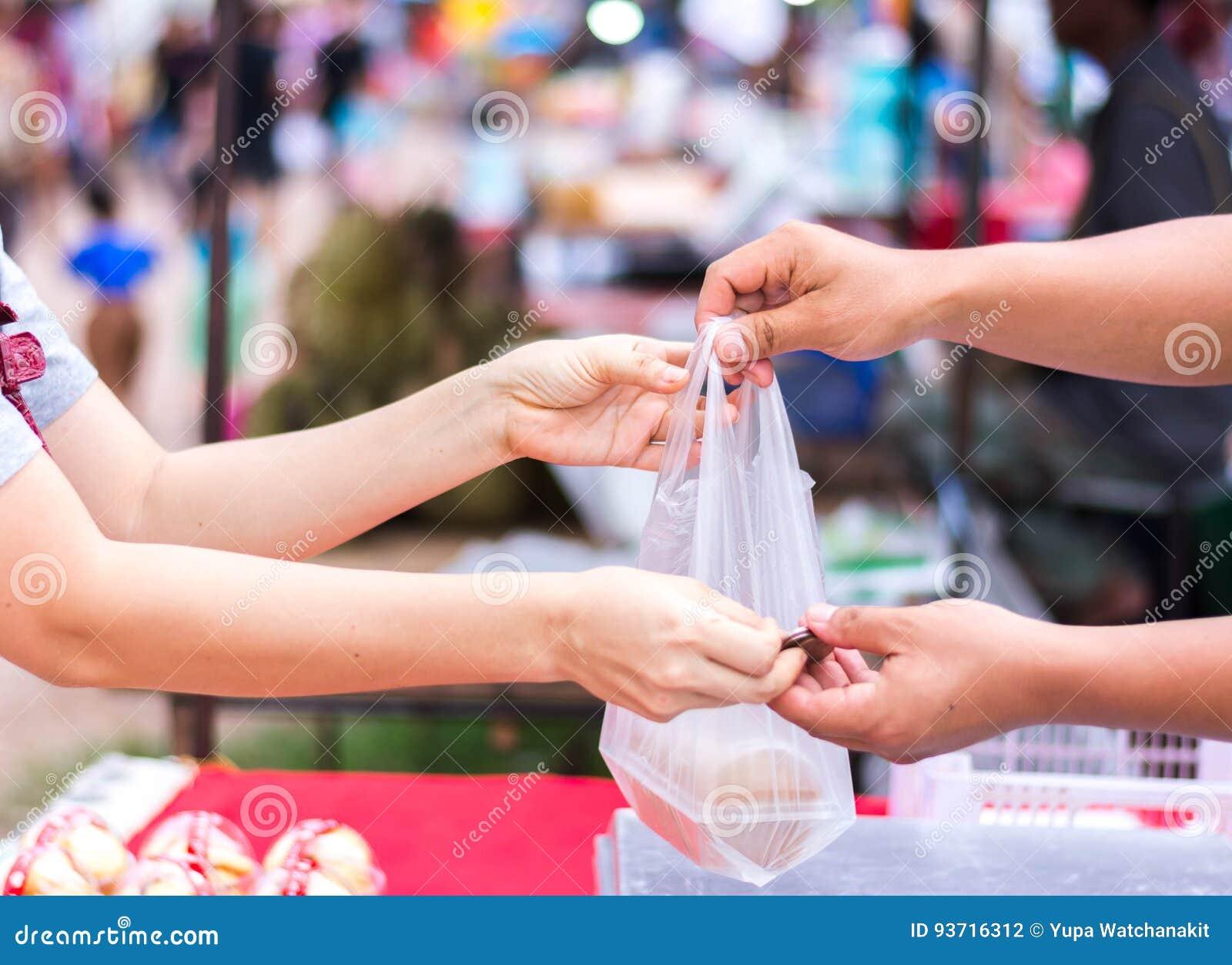 Customer paying bill by cash at market