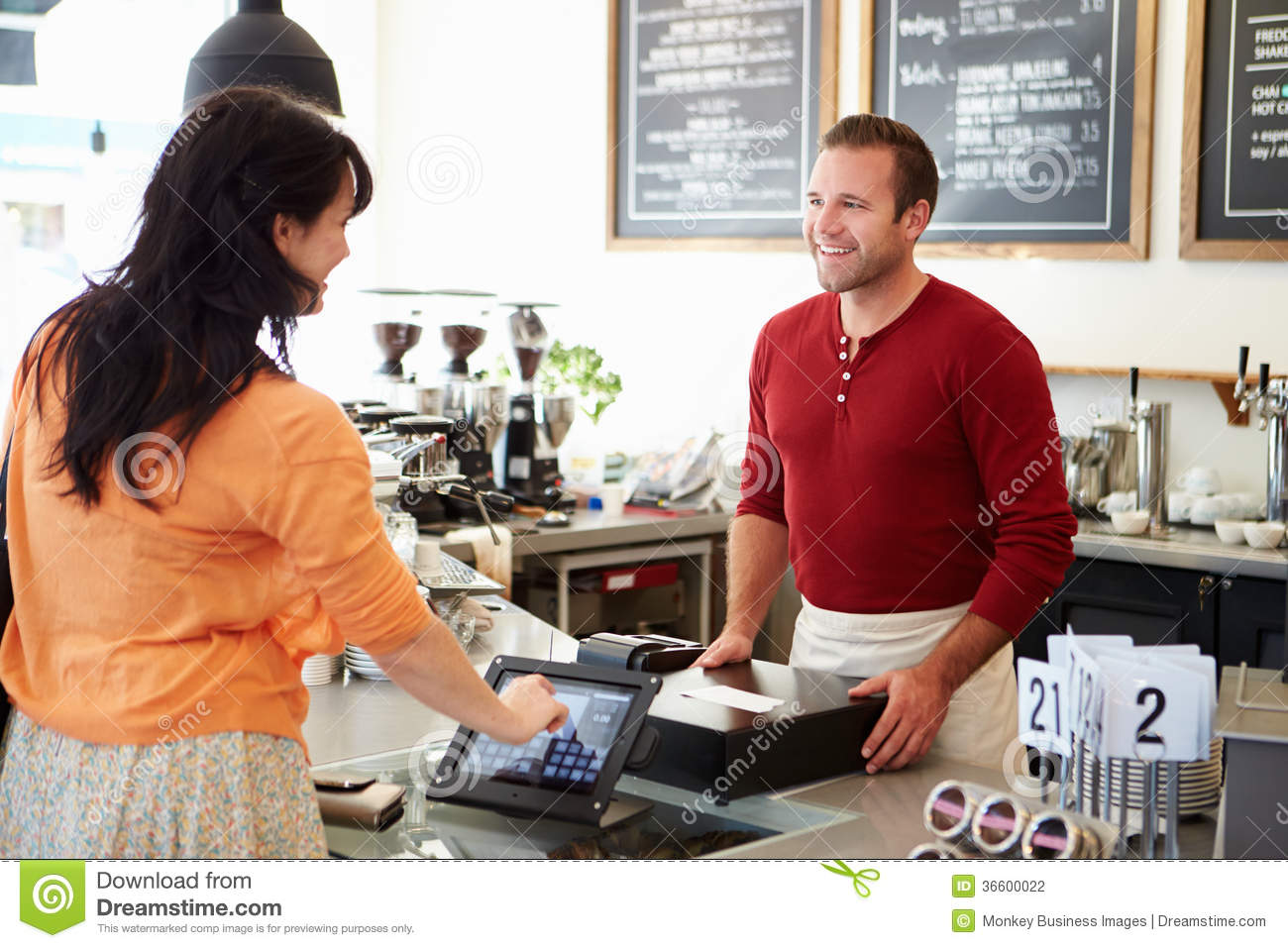 Customer Paying In Coffee Shop Using Touchscreen Stock