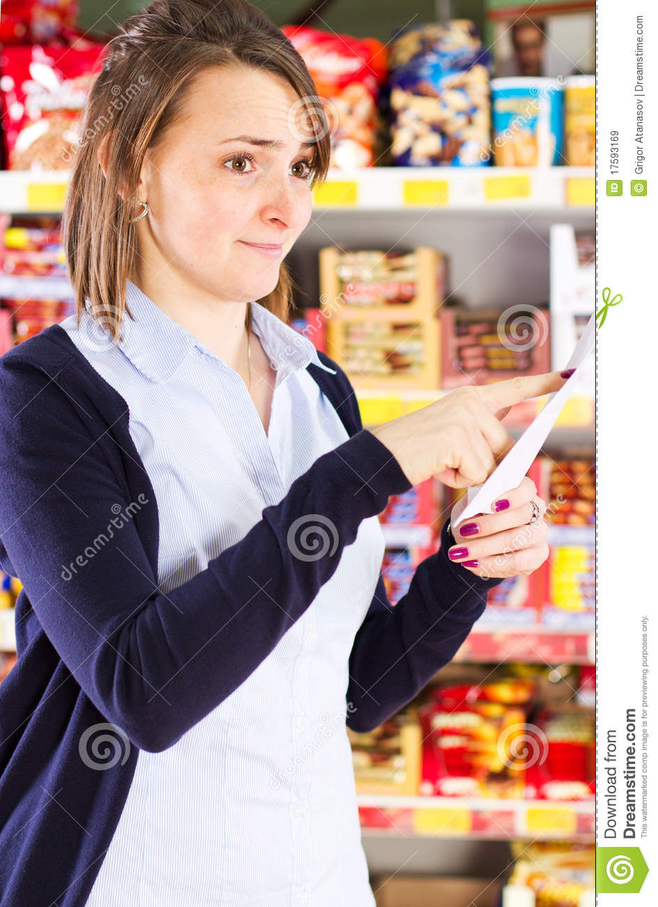 Customer pointing at shopping list