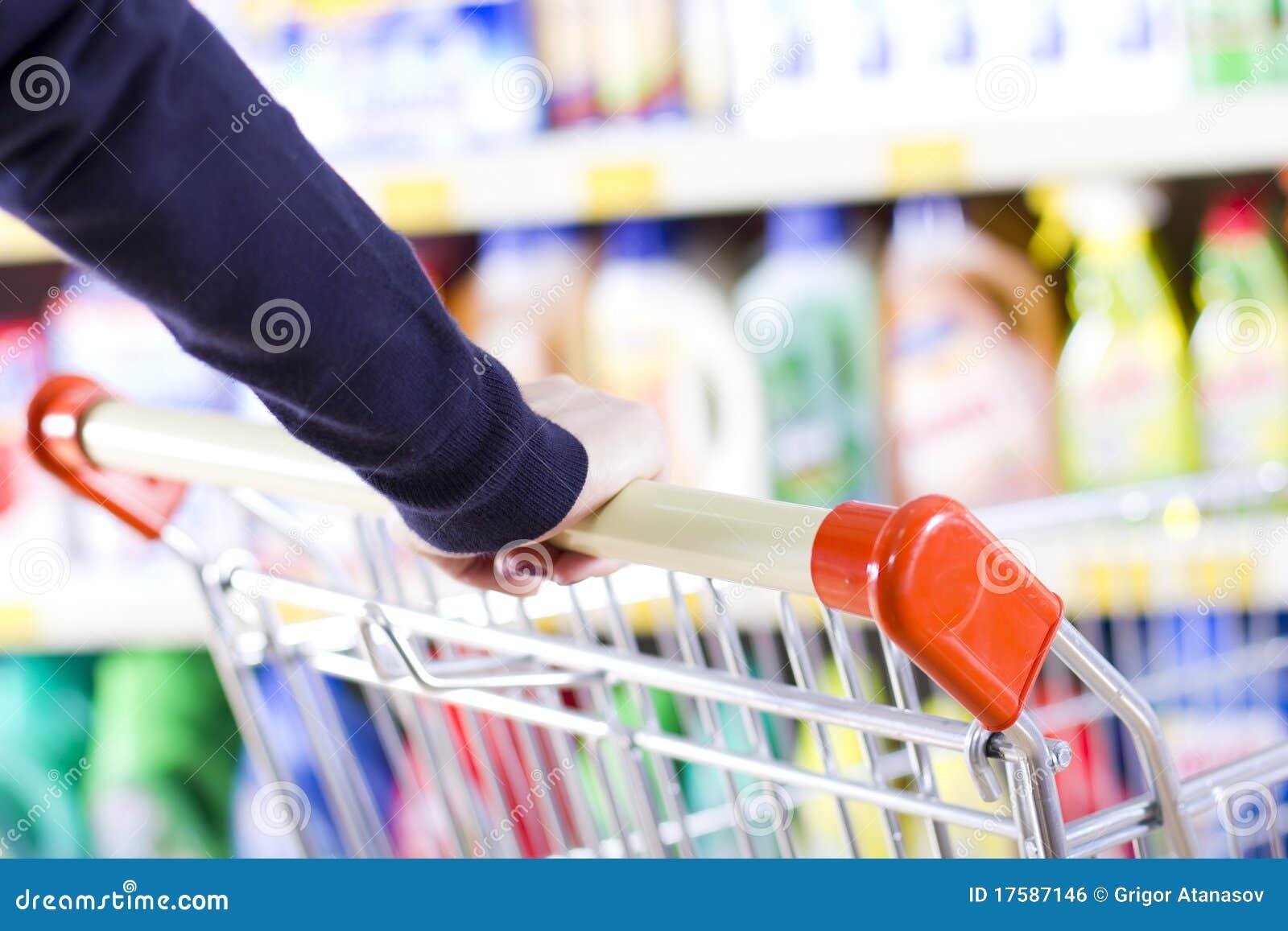 Customer pushing shopping cart