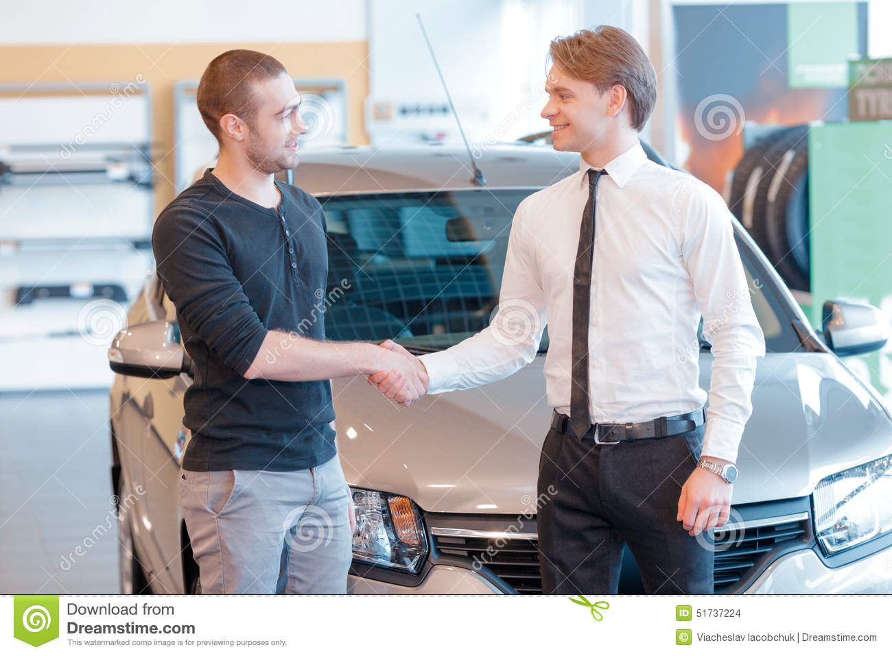 Customer And Sales Consultant With Showroom View Stock Photo ...