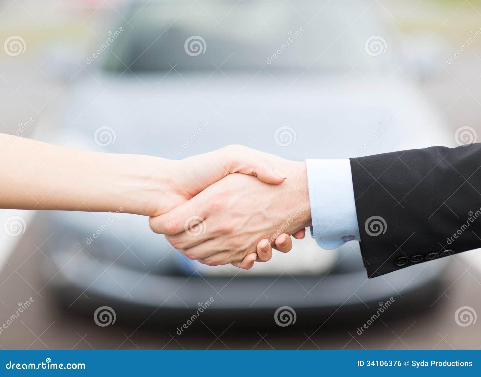 customer and salesman shaking hands royalty free stock image