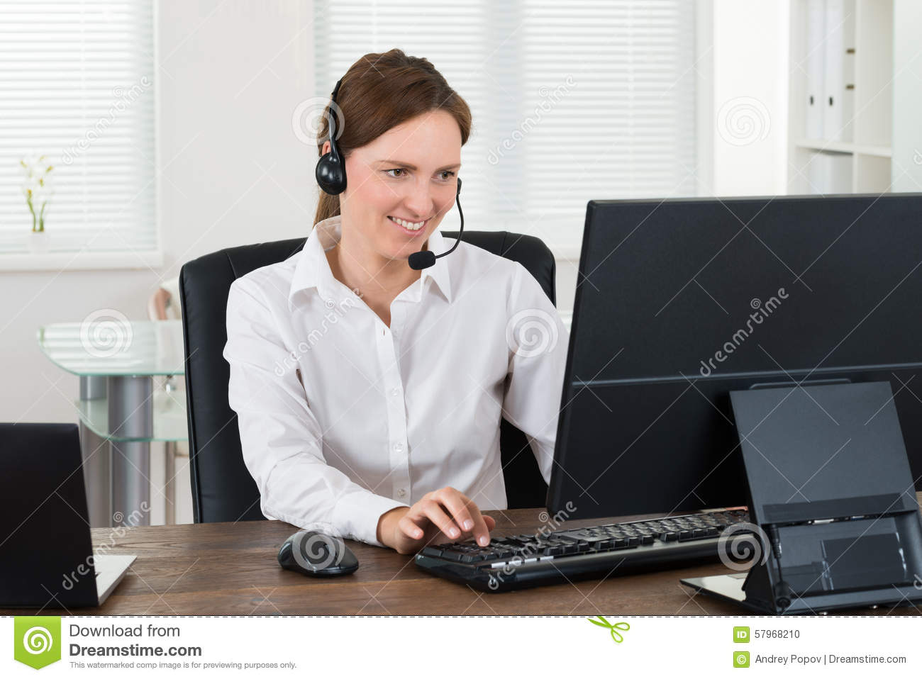 customer service representative working on computer stock photo customer service representative working on computer
