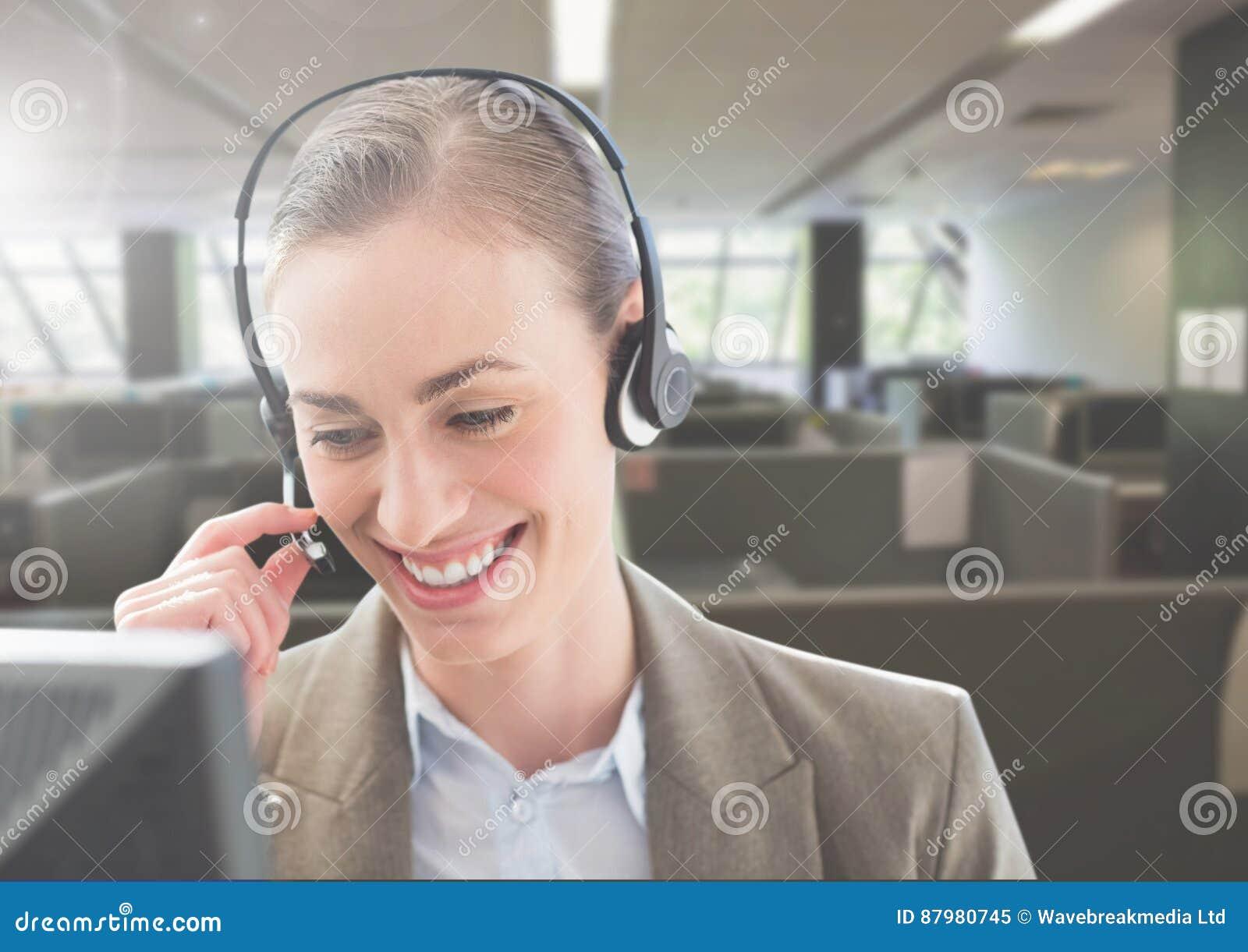 Customer service woman talking on headphone in office