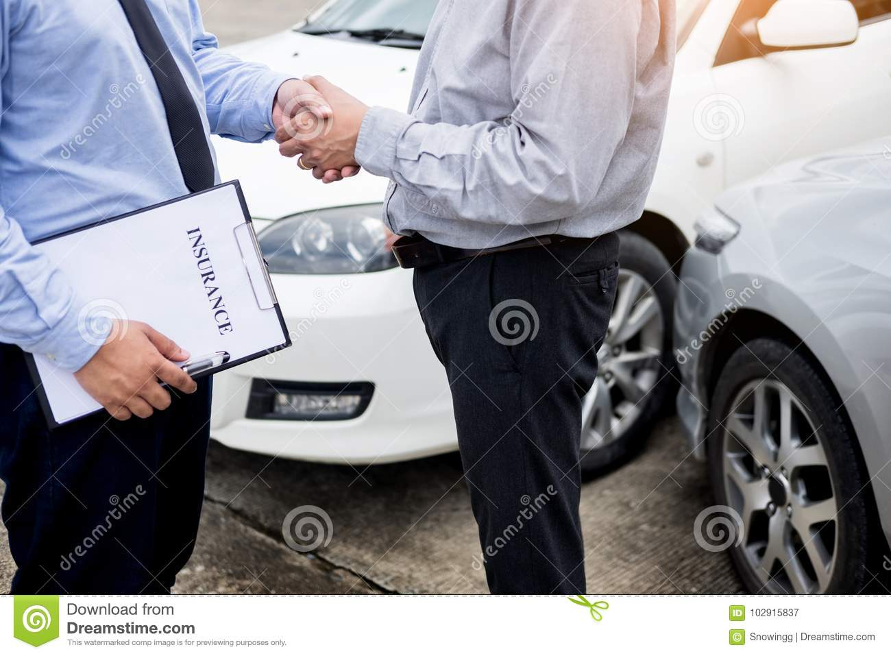 Customer Shake Hand With Auto Insurance Agents After Agreeing To ...