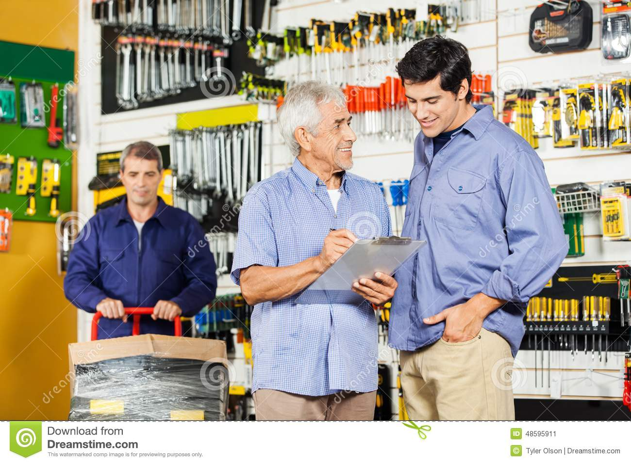 customers checking checklist in hardware store stock image image 48595911. Black Bedroom Furniture Sets. Home Design Ideas