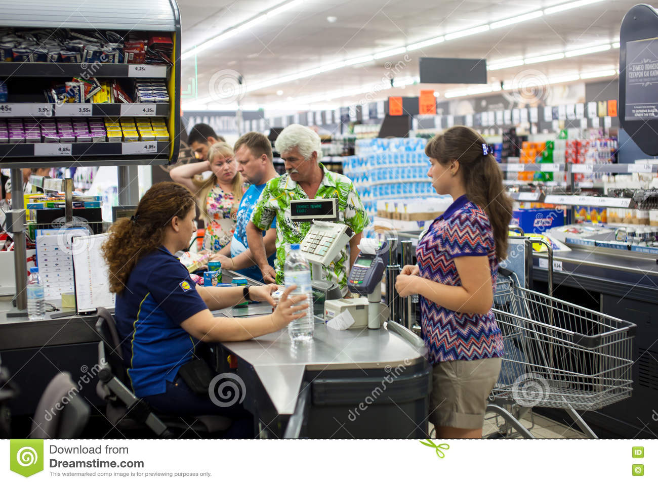 Customers Paying For Shopping At A Supermarket. Line At ...