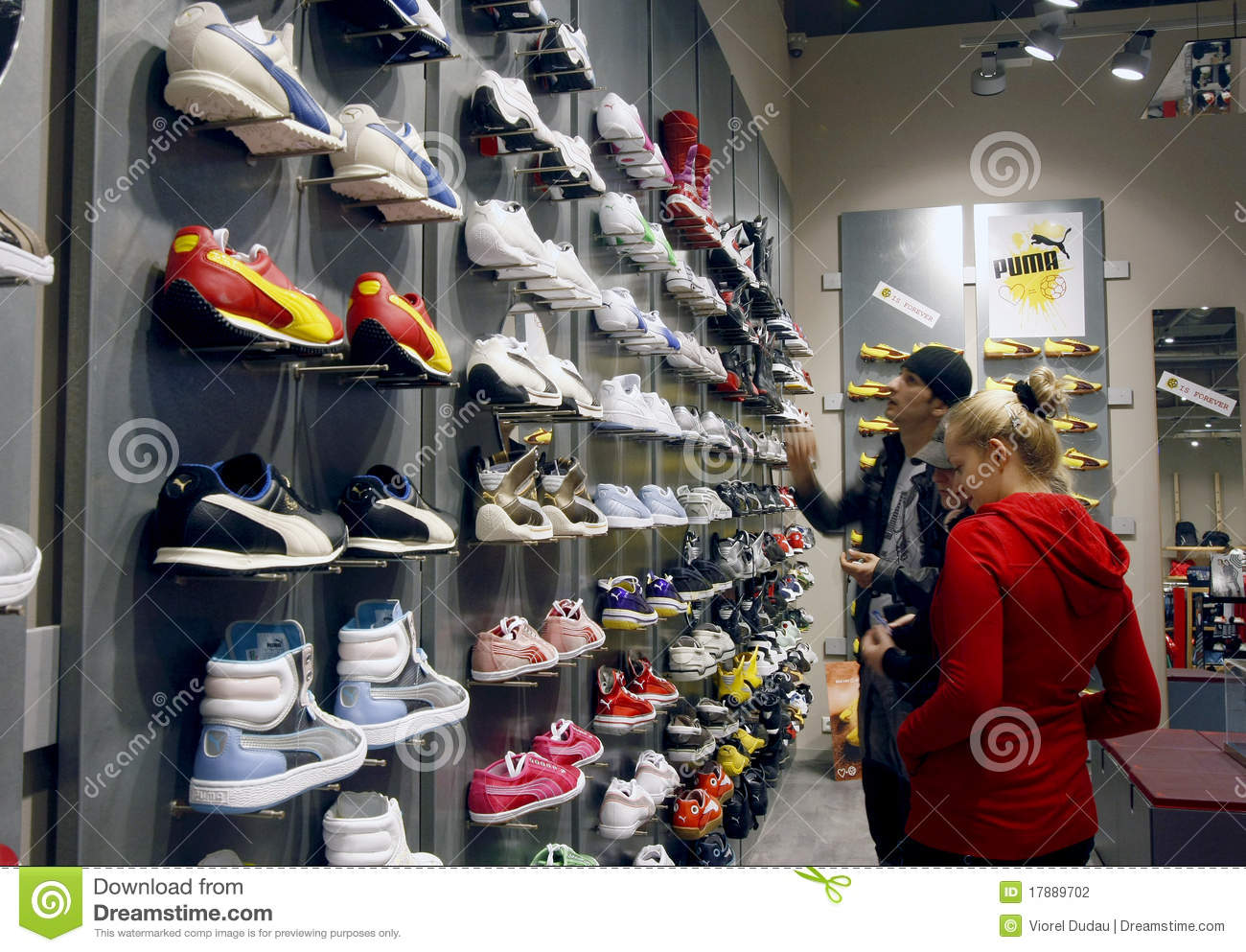 Customers are shopping for sports equipment shoes inside a Puma shop  located in a mall a474c16c239e