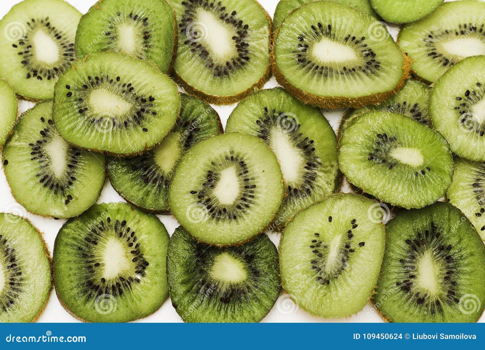The cut kiwi fruit. Close-up background texture