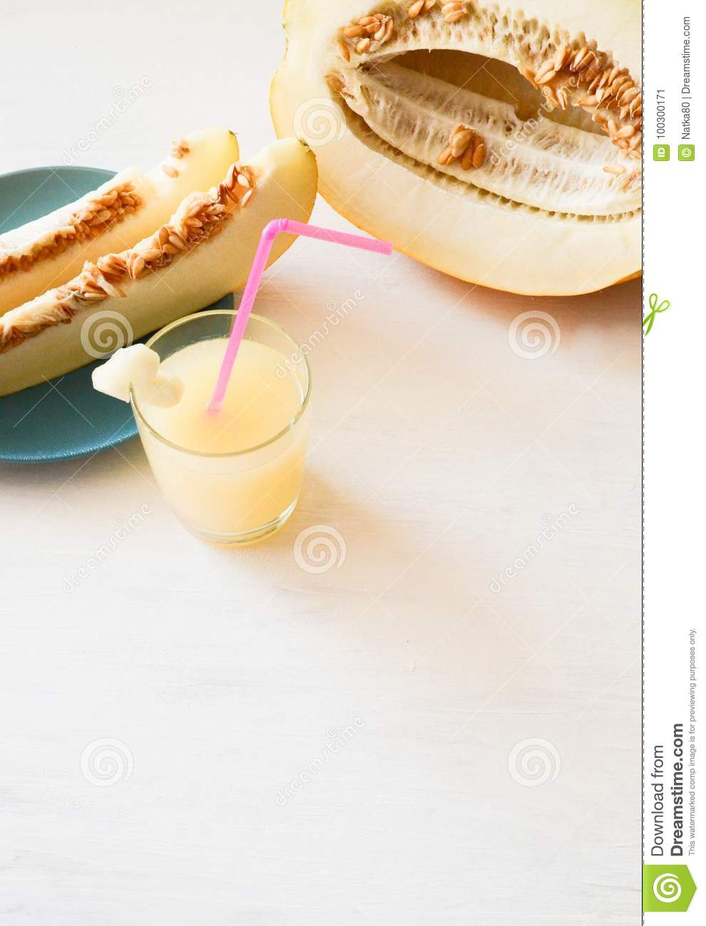 Cut melon next , slices of melon on a plate glass of smoothie with a slice of melon with a straw