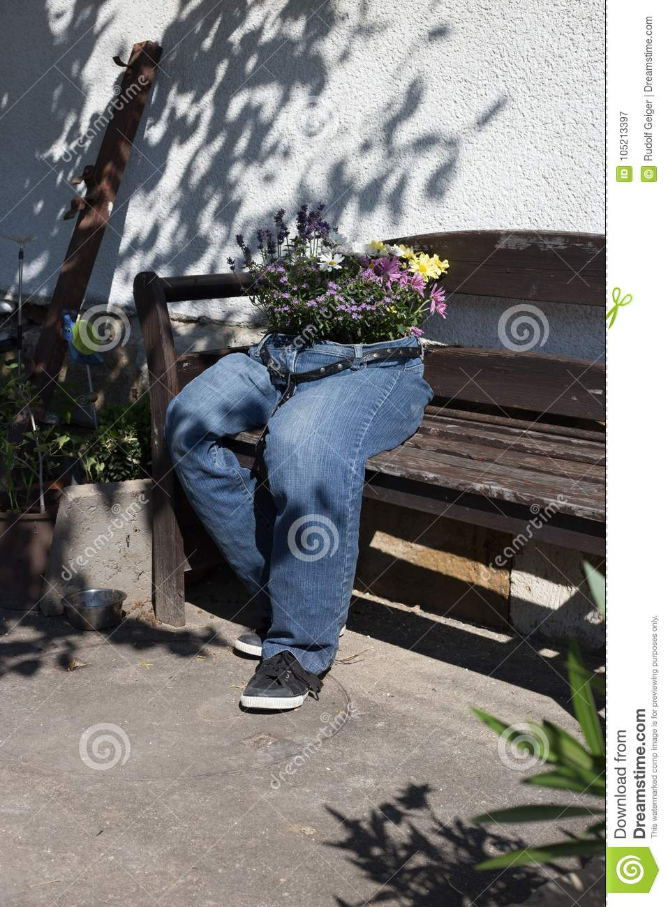 Cut Off Jeans Decorated With Flowers Sitting On A Garden Bench A