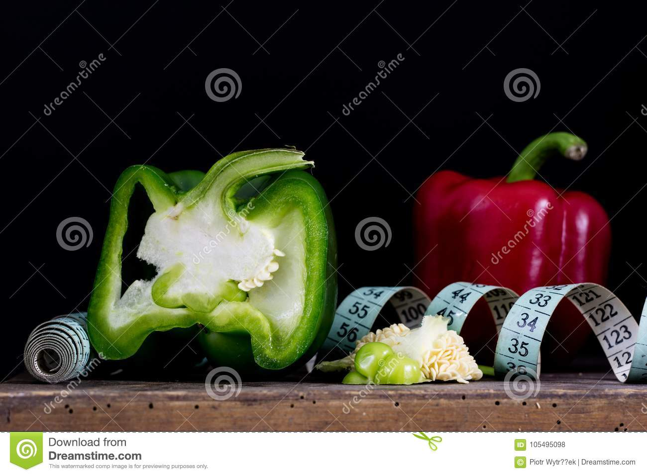 Cut Out Green Peppers On Old Kitchen Table And Measure Tailor V