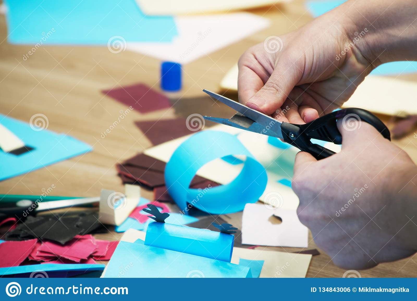 Cut with scissors colored paper and do crafts. Scrapbooking and other hobbies