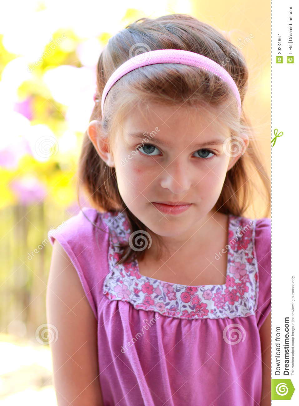cute little 8 year old girl in a pink blouse with brown hair ...
