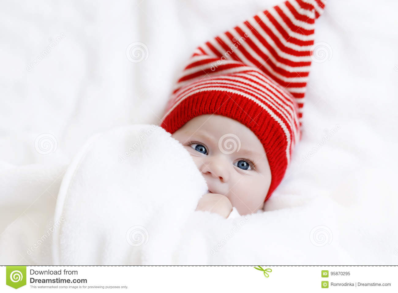 3c9e2be243e Cute adorable baby child with Christmas winter cap on white background