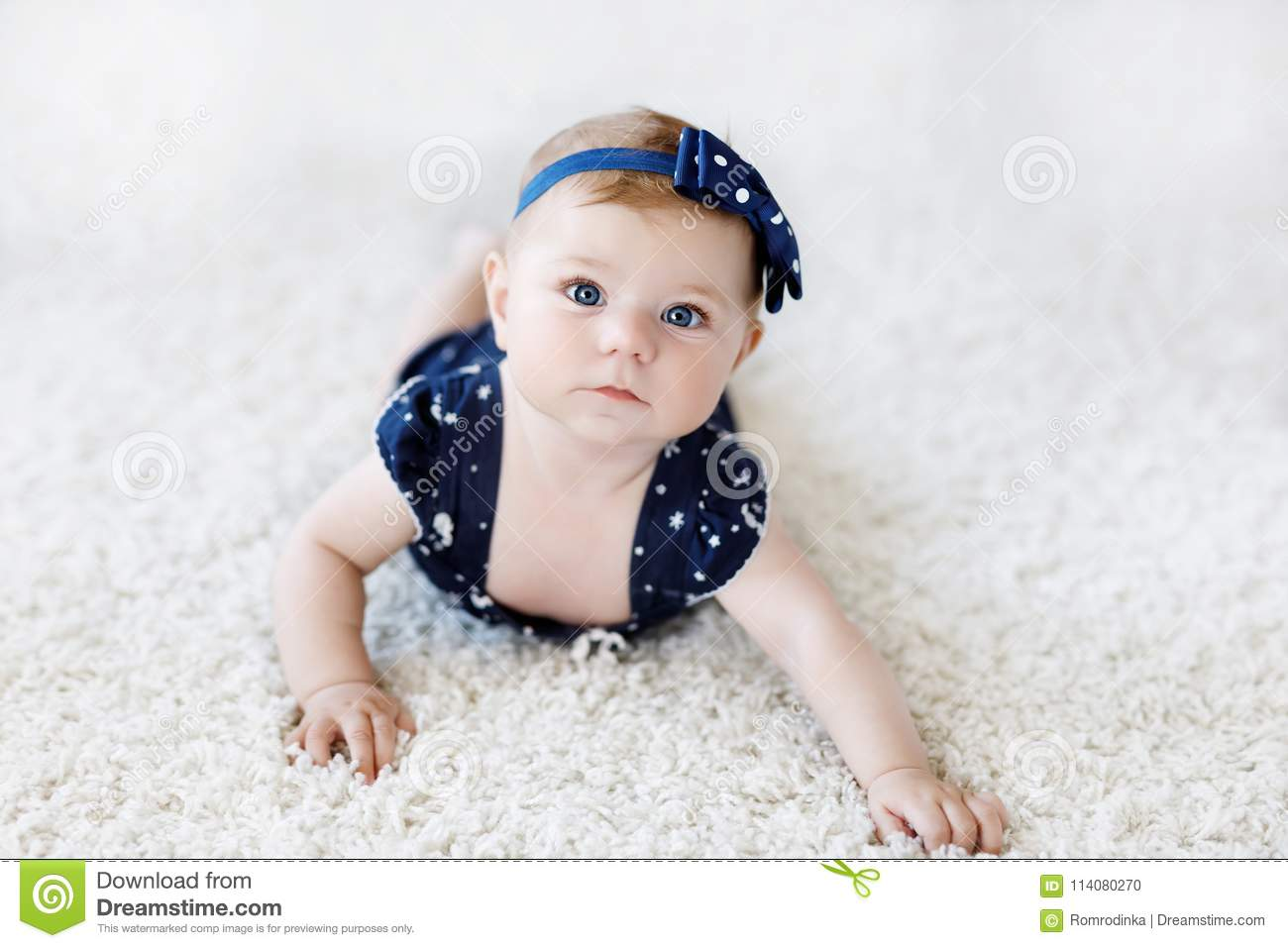 995eb1ad8 Cute Adorable Baby Girl In Blue Clothes And Headband. Stock Photo ...