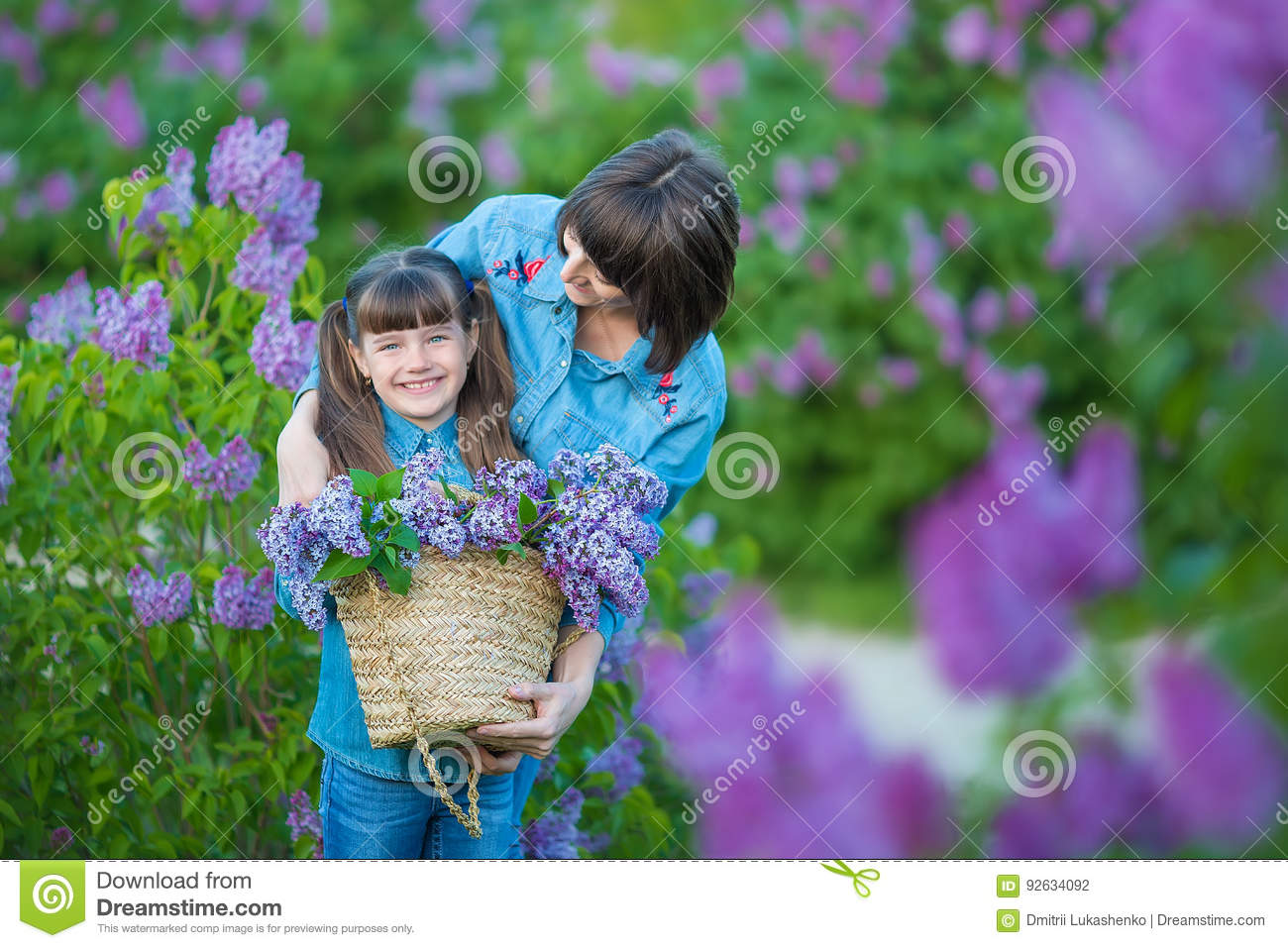 Download Cute Adorable Beautifull Mother Lady Mom Woman With Brunette Girl Daughter In Meadow Of Lilac