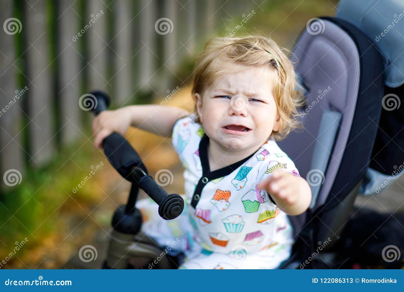 f56e9c67b Cute Adorable Crying Sad Toddler Girl Sitting On Pushing Bicyle Or ...