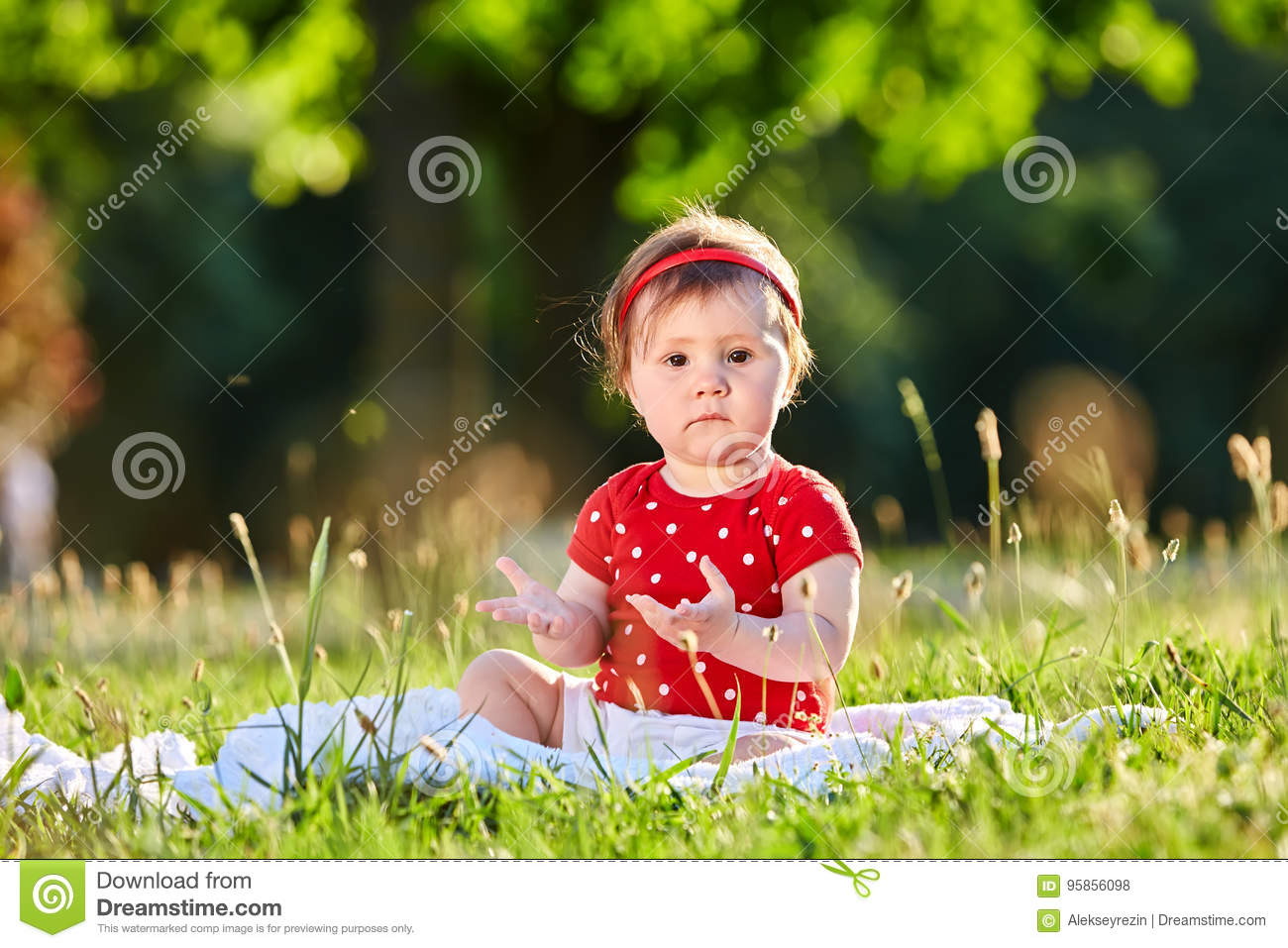 Image of: Baby Girl Cute Adorable Nice Baby Girl In Red Spring Dress Smiling Sitting Under The Tree Dreamstimecom Cute Adorable Nice Baby Girl In Red Spring Dress Smiling Sitting