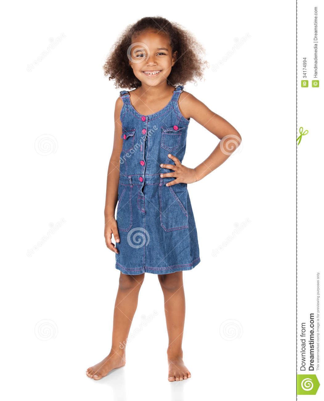 Adorable cute african child with afro hair wearing a denim dress. The ...