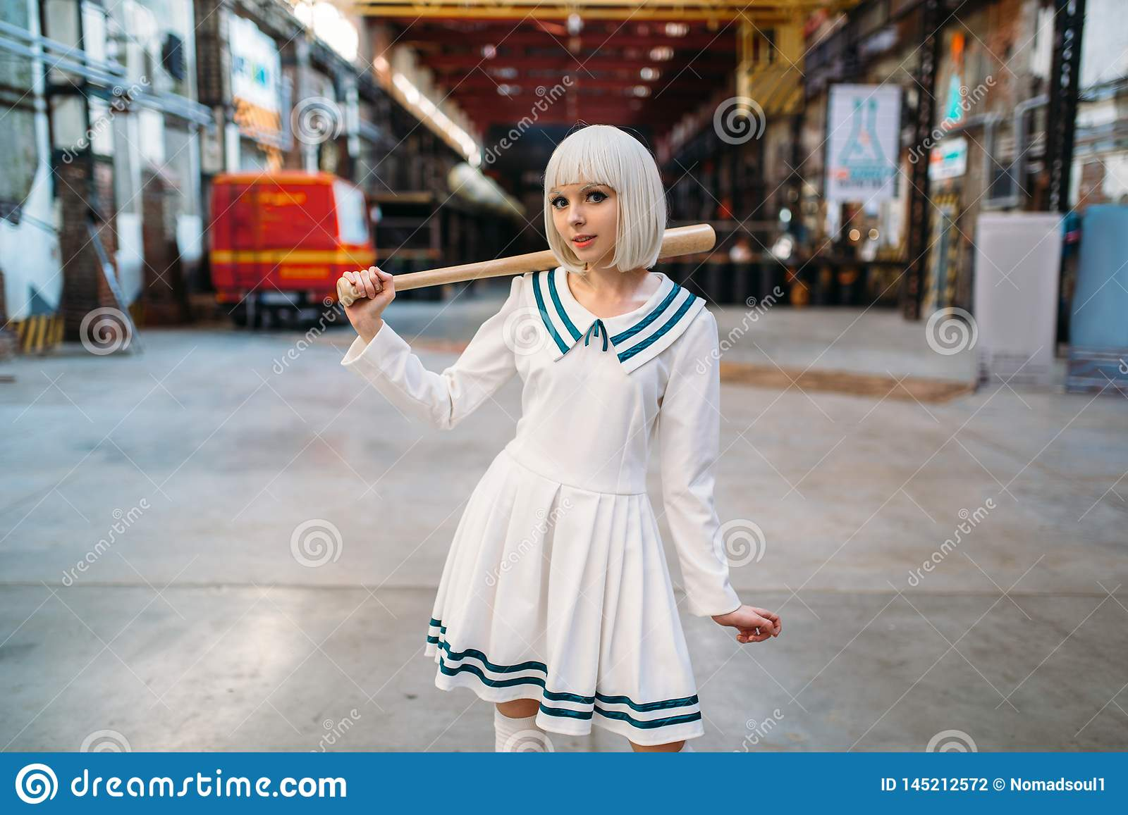 Cute anime style blonde girl with baseball bat