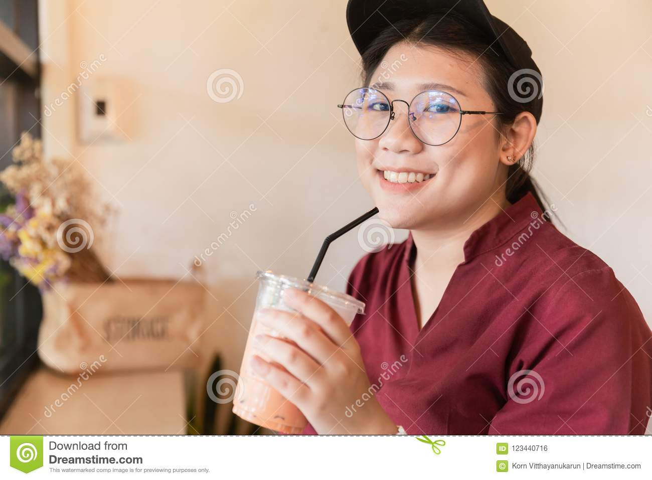 613201f25835 Cute Asian fat plus size girl teen drinking ice coffee using straw in cafe.  More similar stock images