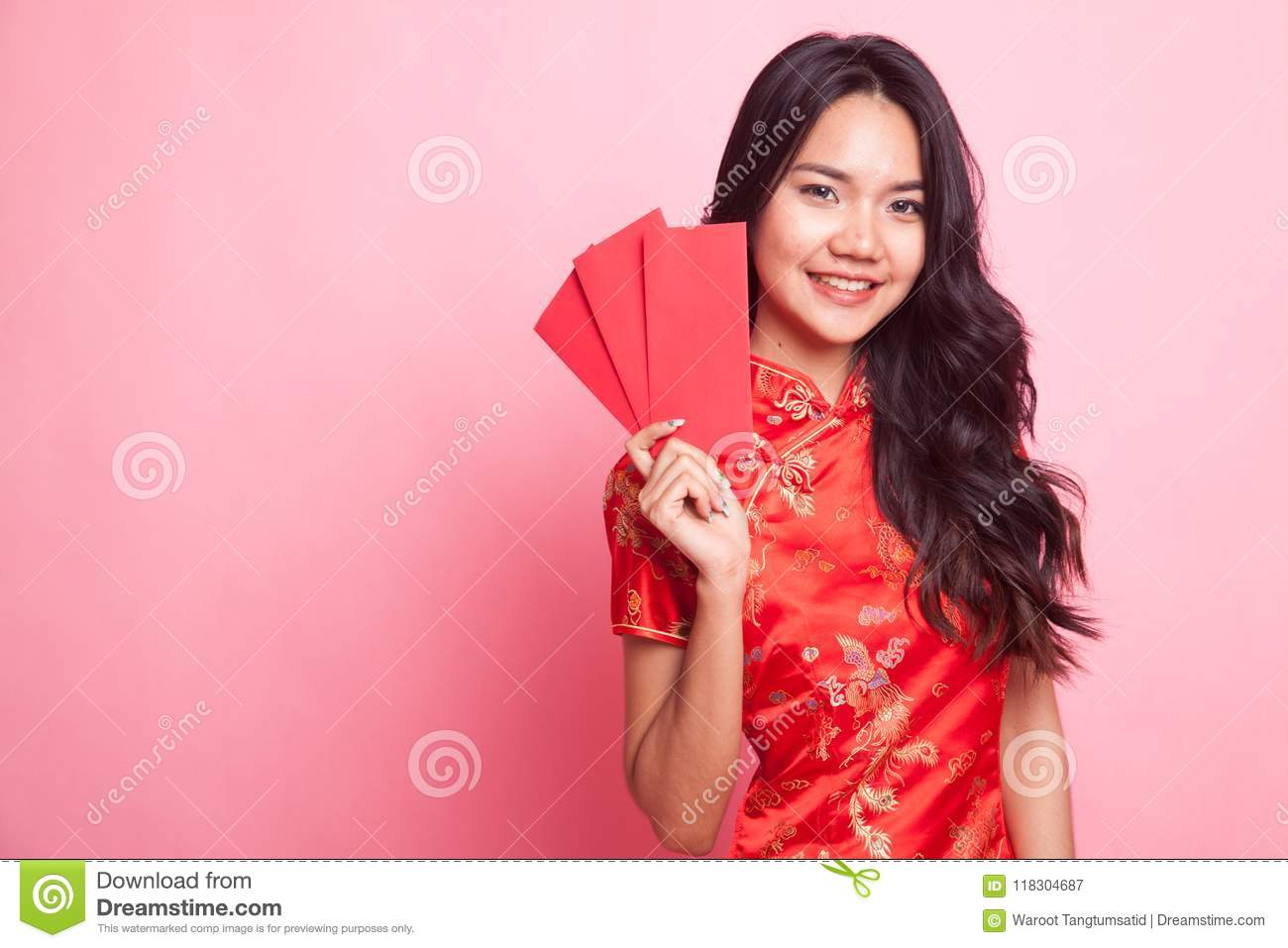 cb1d83093 Royalty-Free Stock Photo. Cute Asian girl in chinese red cheongsam dress  with red envelope