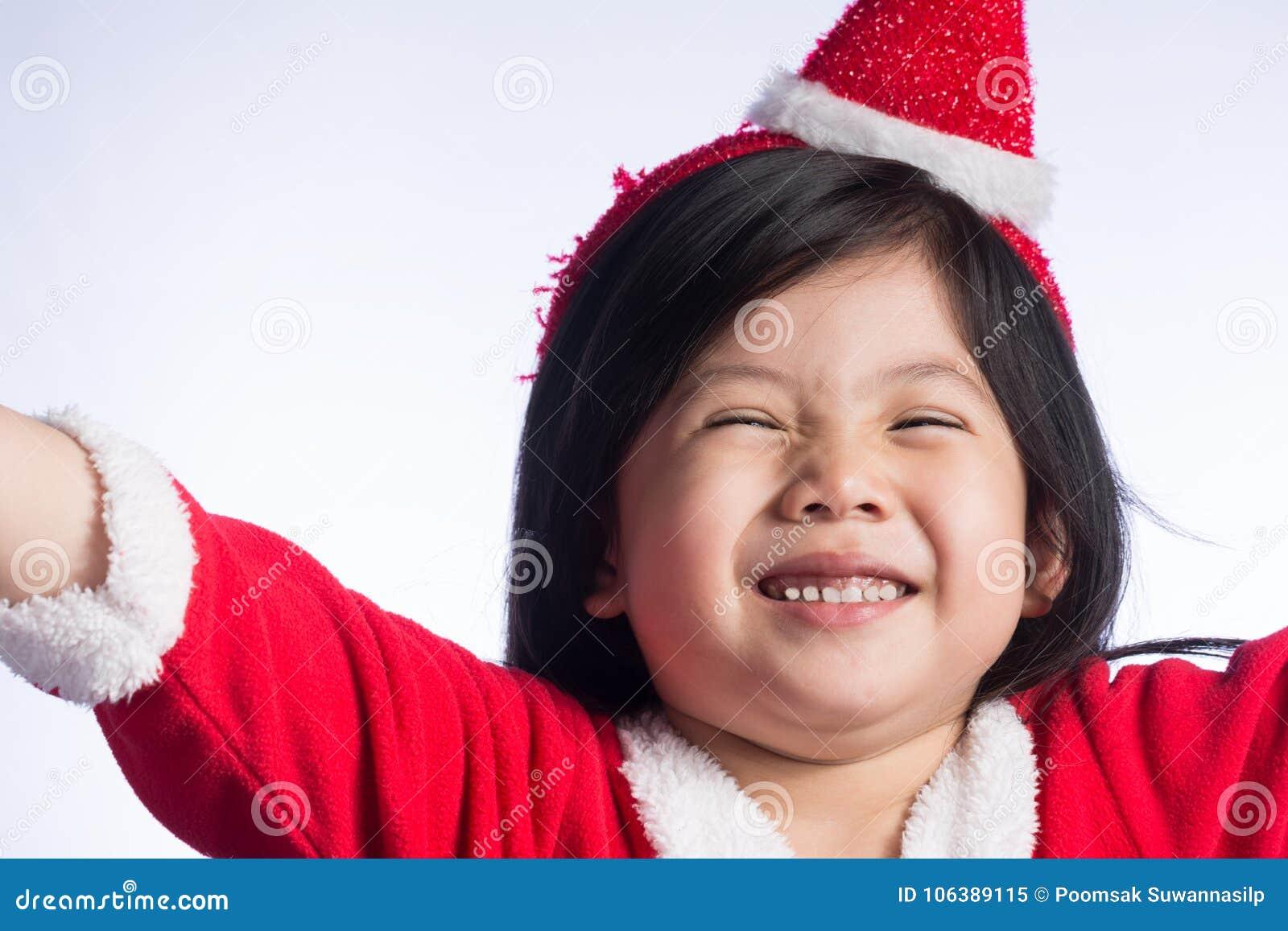 1e957408da7bf A Little Cute Asian Girl In Santa Cross Dress On White Background ...