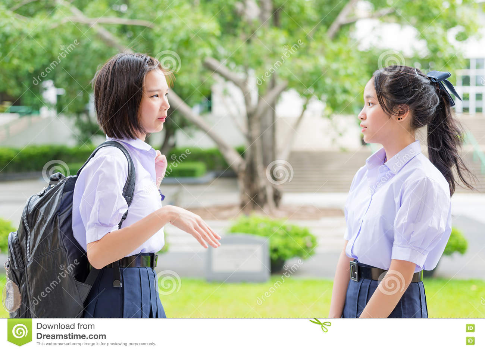 Cute Asian Thai high schoolgirls student talking