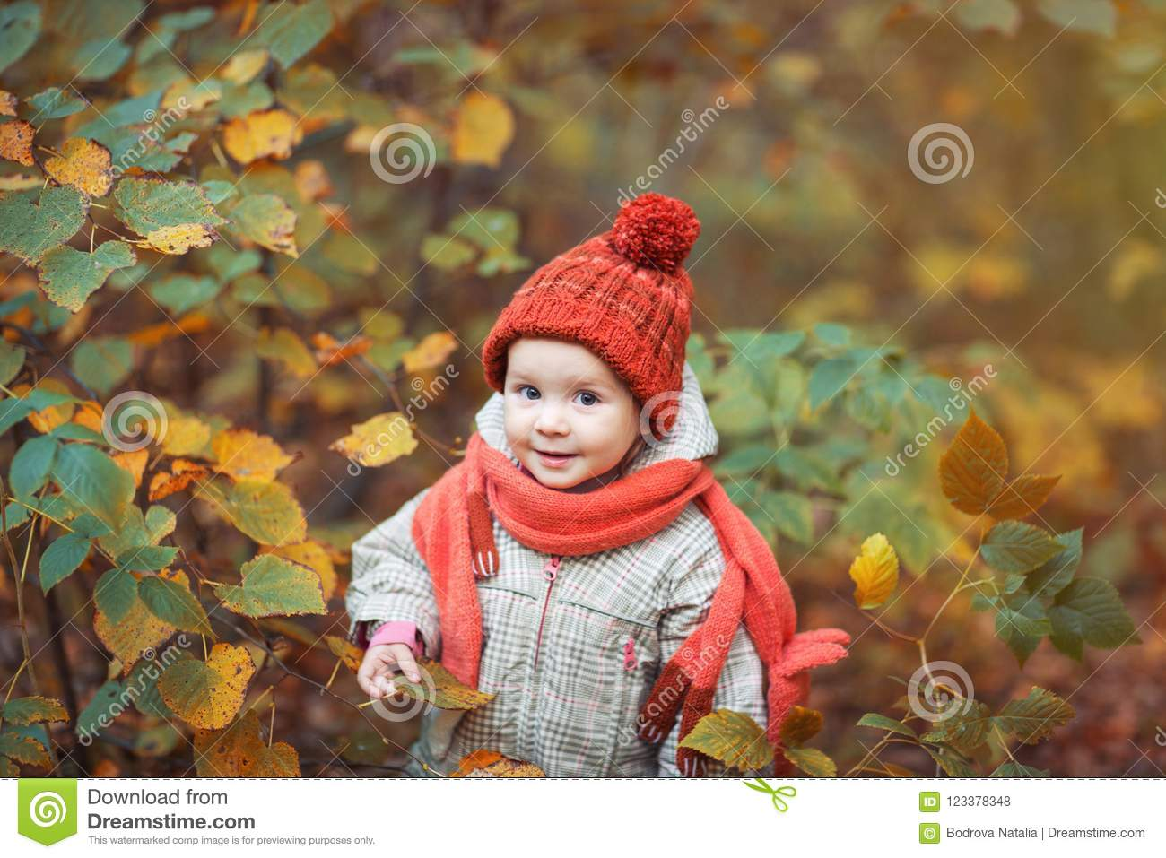 e04f3482f Cute Baby In Autumn Clothes. Child In Knitted Hats And Scarf Stock ...