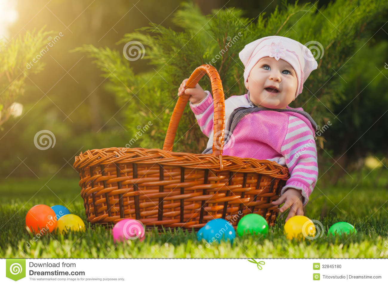 Cute baby in basket in the green park