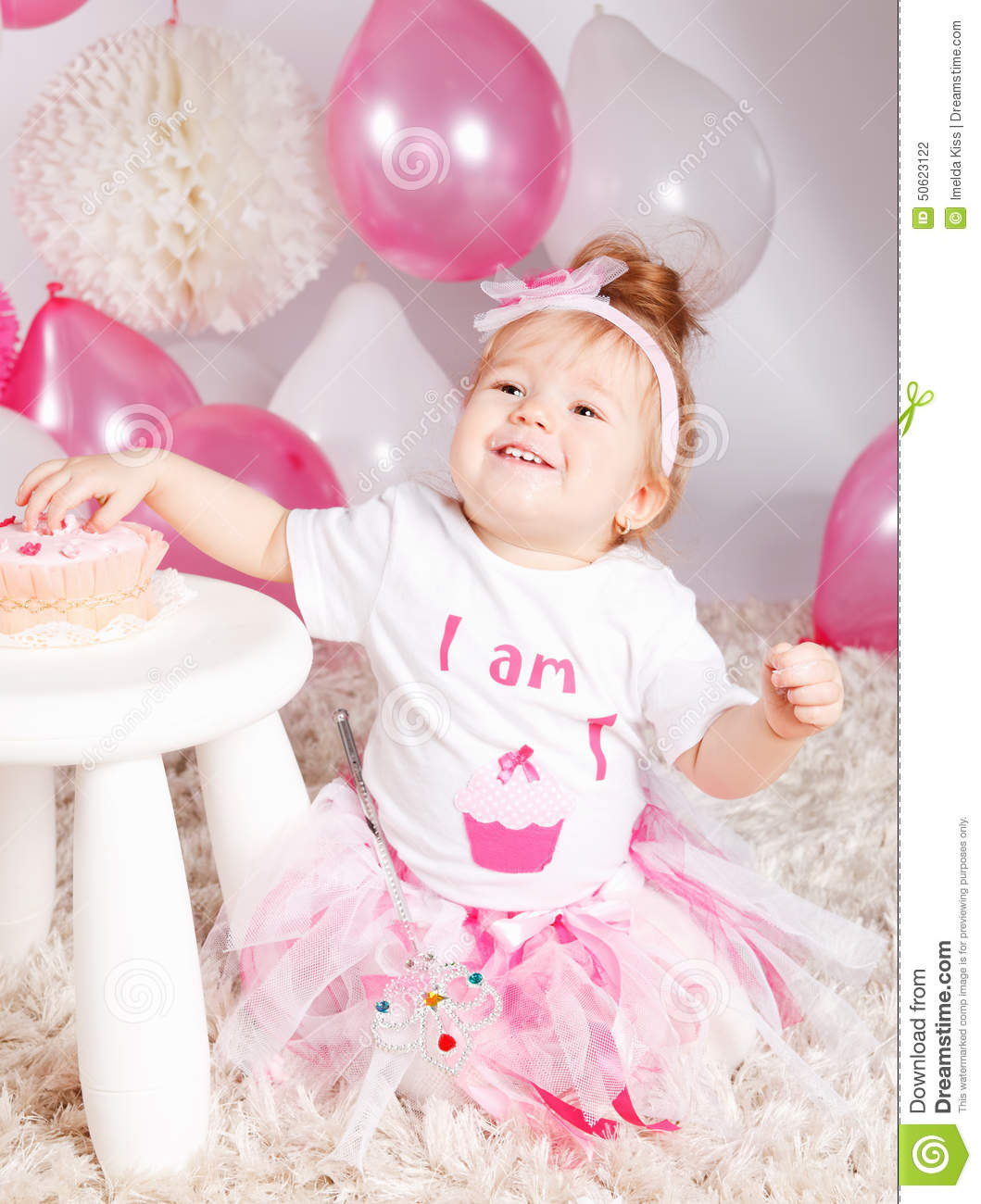 Cute baby with birthday cake