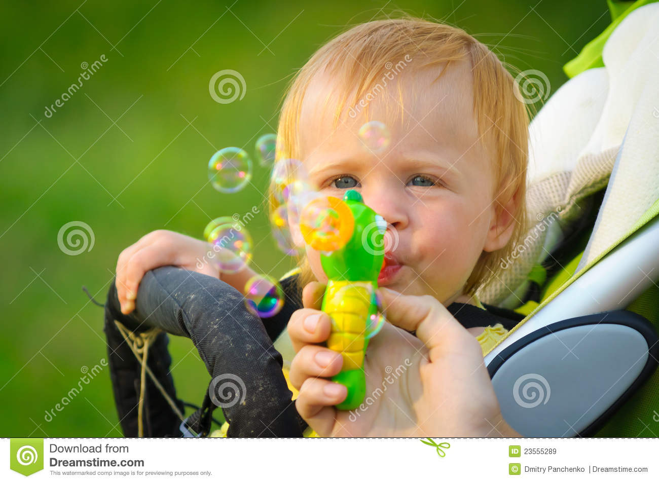 Cute Baby Blowing Bubbles Royalty Free Stock Images - Image: 23555289