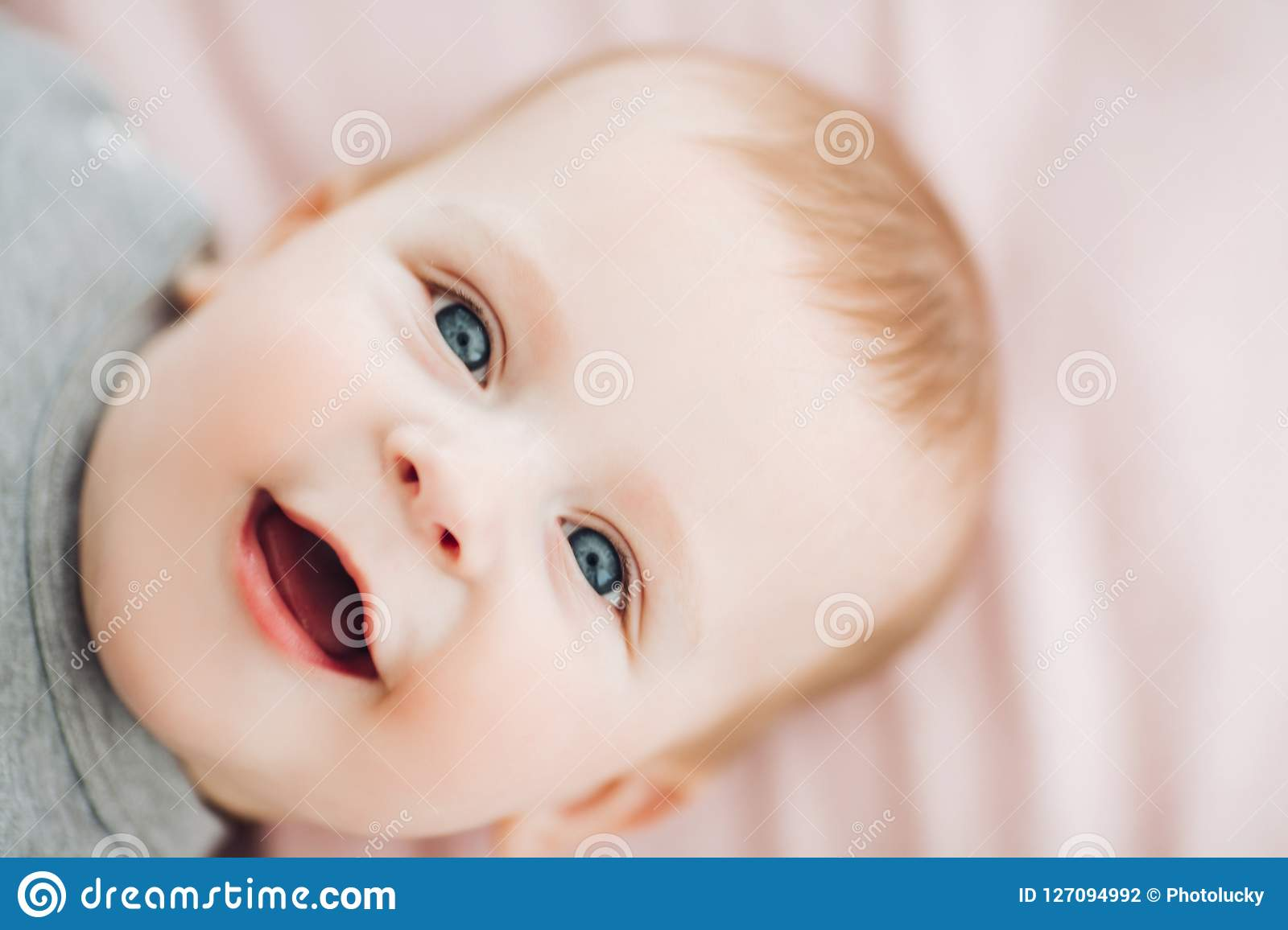 19be5ef15 Cute Baby Boy With Big Blue Eyes. Stock Photo - Image of face ...