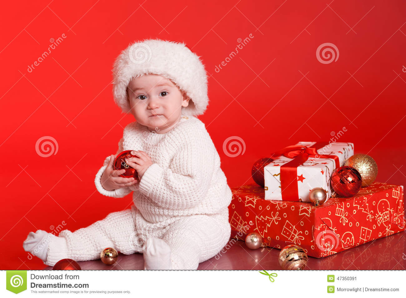 Cute Baby Boy With Christmas Decorations Over Red Stock