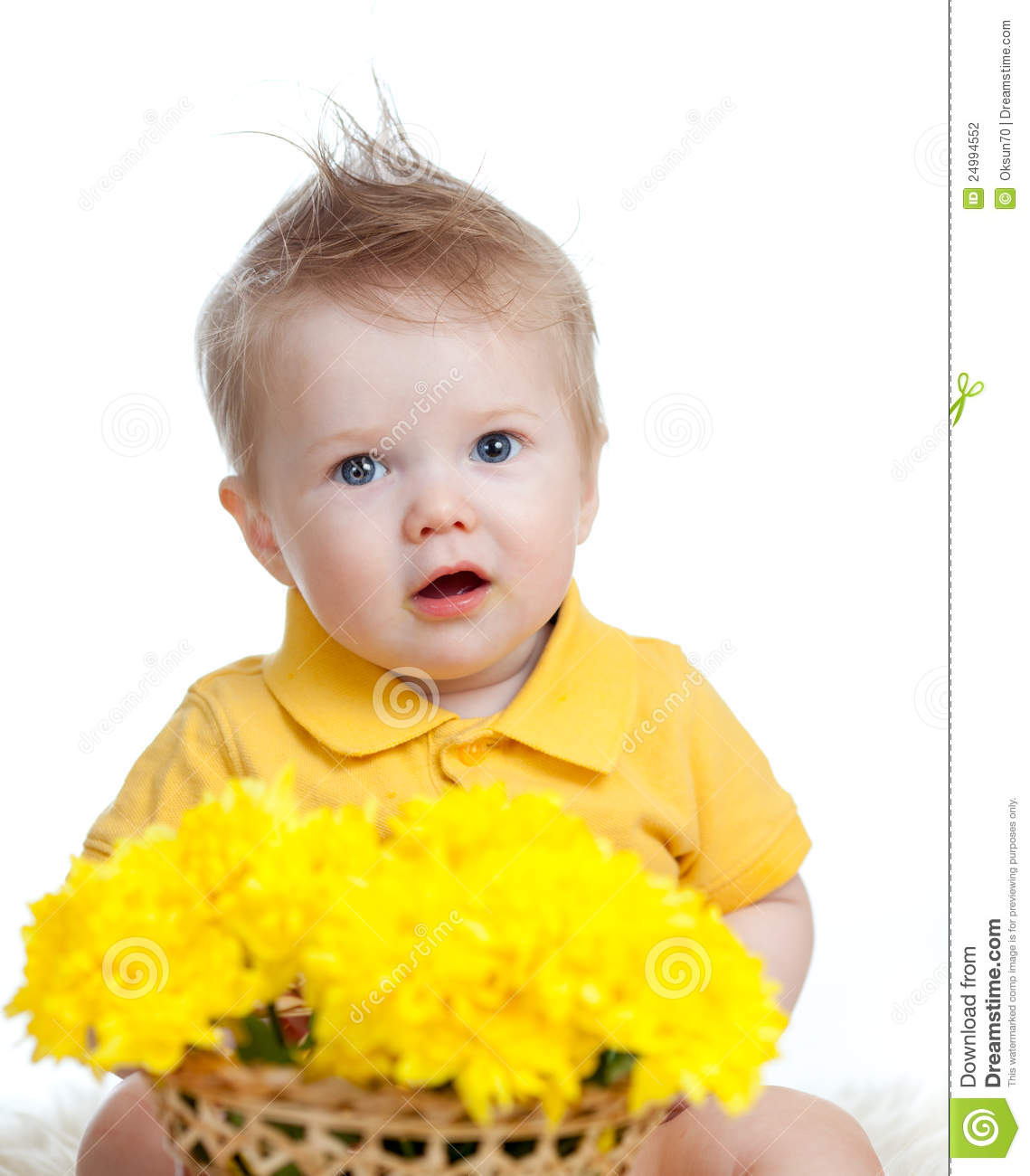 cute baby boy holding basket with yellow flowers stock photo - image