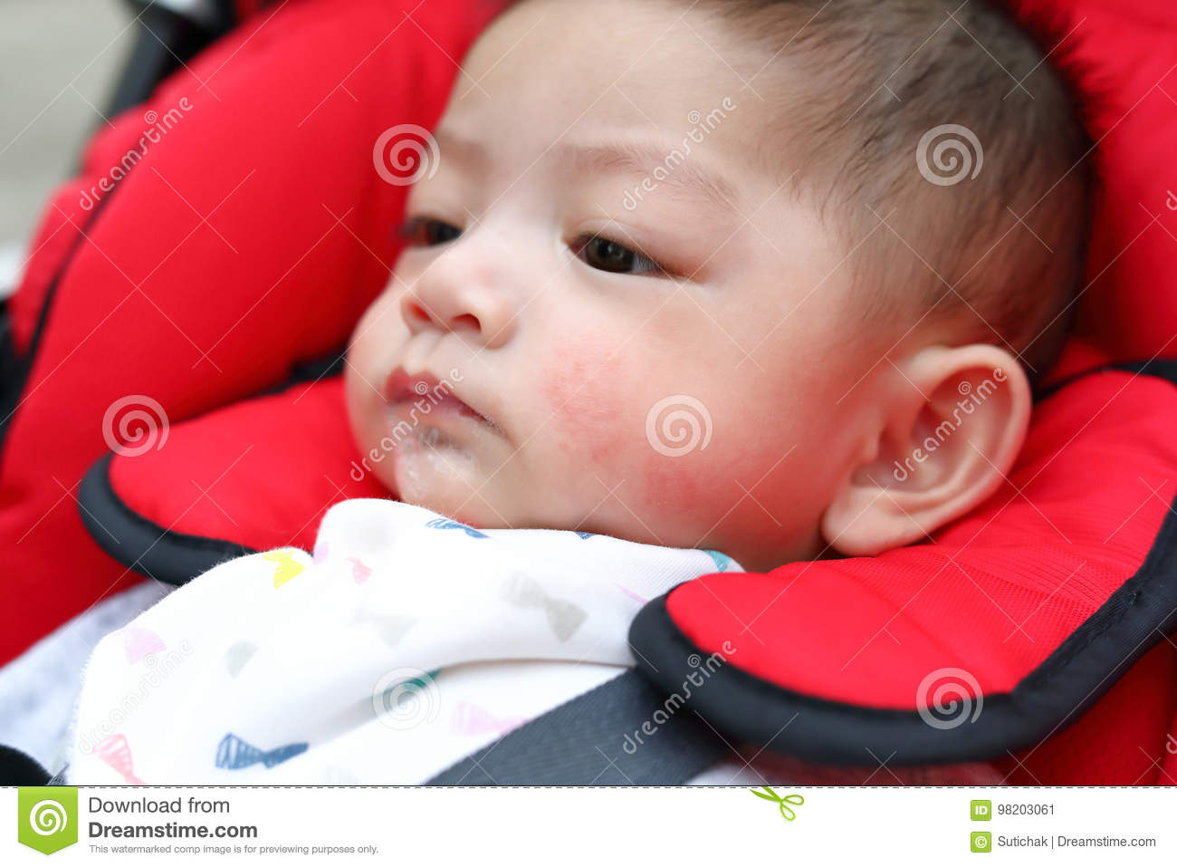 cute baby boy playful bubbles saliva drool on child mouth stock