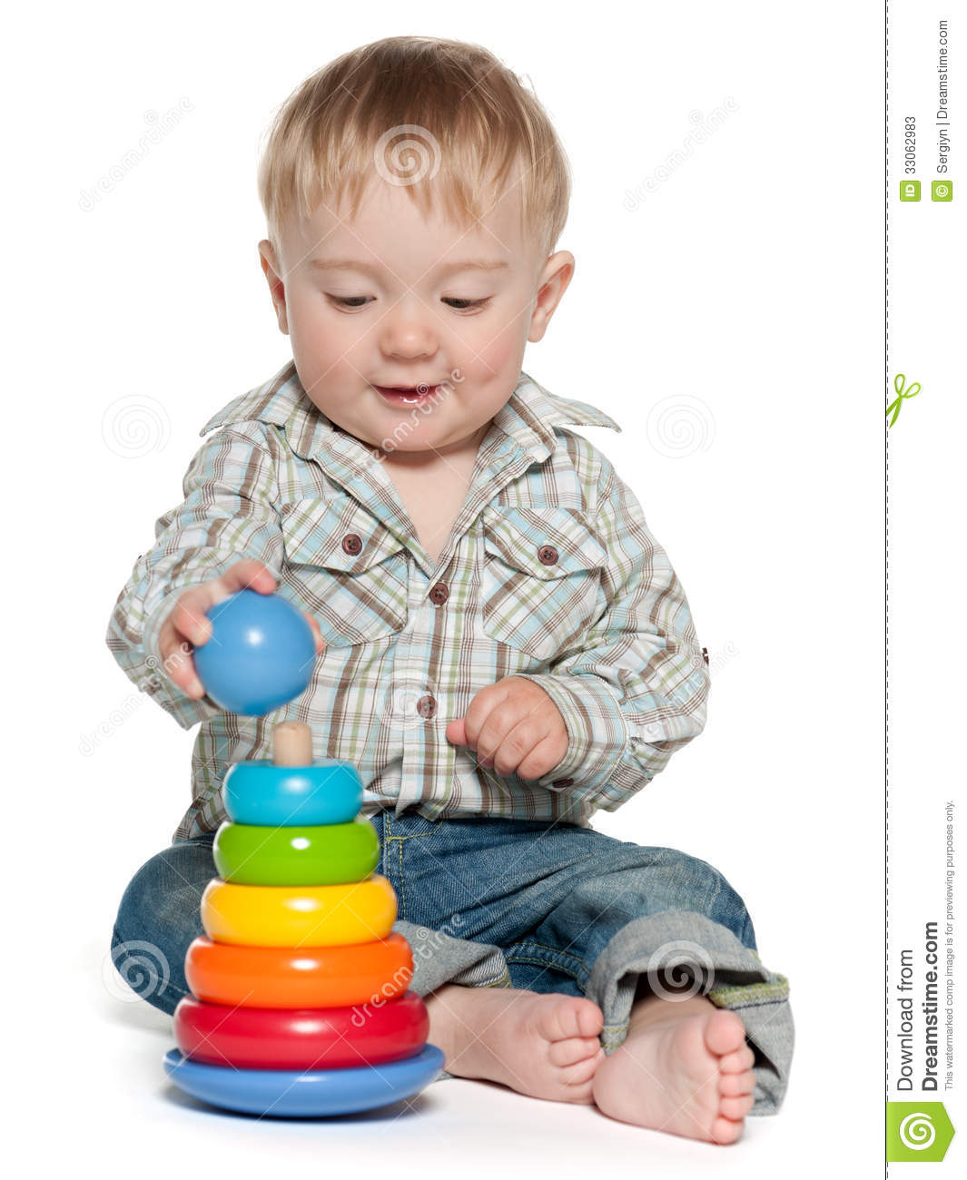 Boy Toys Baby : Cute baby boy is playing with toys stock photos image