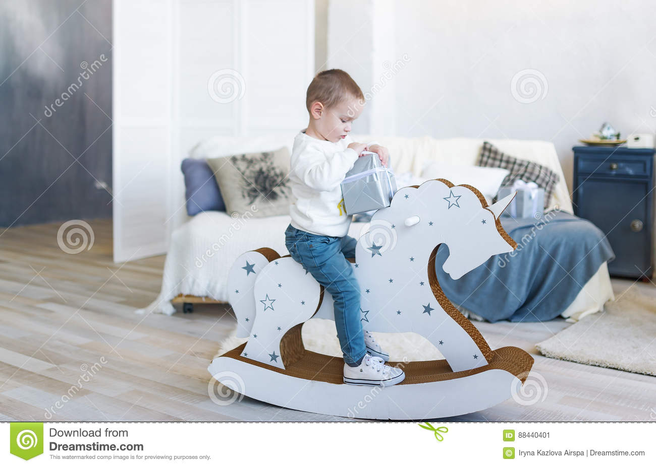 Baby Bedroom In A Box Special: Cute Baby Boy Riding Wooden Traditional Rocking Horse Toy
