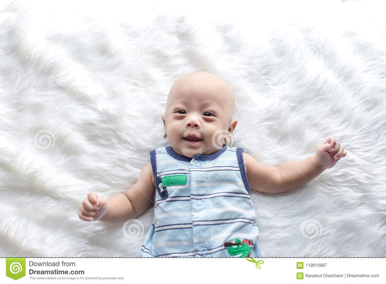 Cute baby boy is shooting in the studio fashion image of baby and family