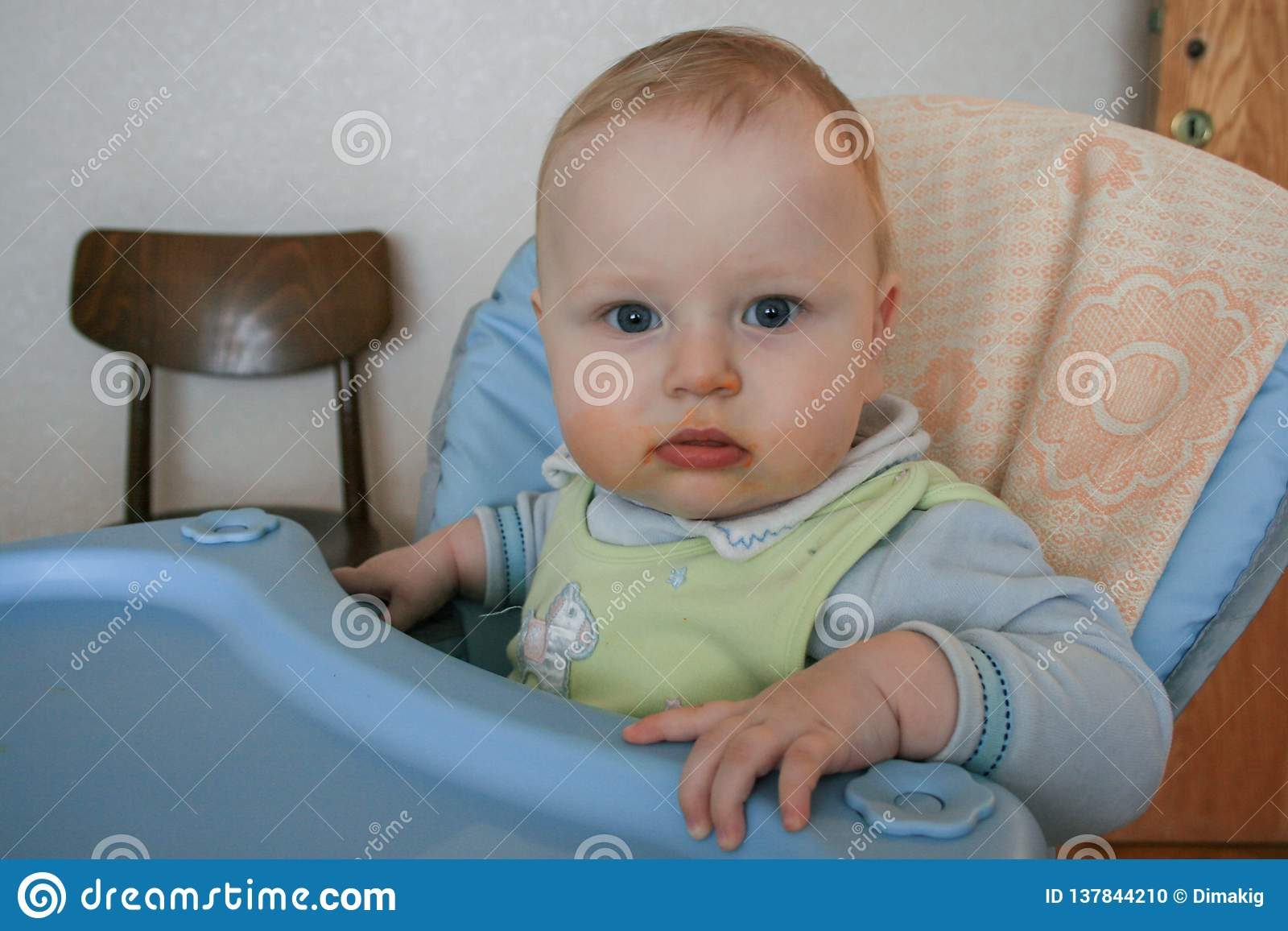 Cute Baby Boy Sitting On The Baby Chair And Waiting Dinner Stock