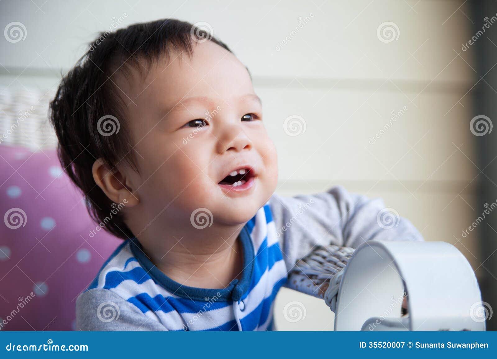 Cute Baby Boy On Sofa Stock Image. Image Of Black